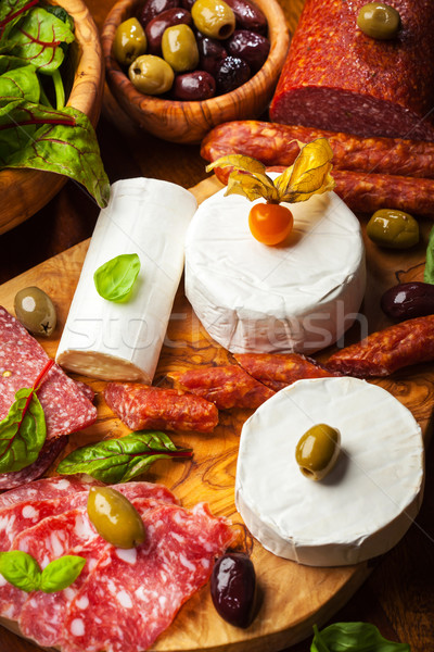 Antipasto catering platter with different meat and cheese products Stock photo © brebca