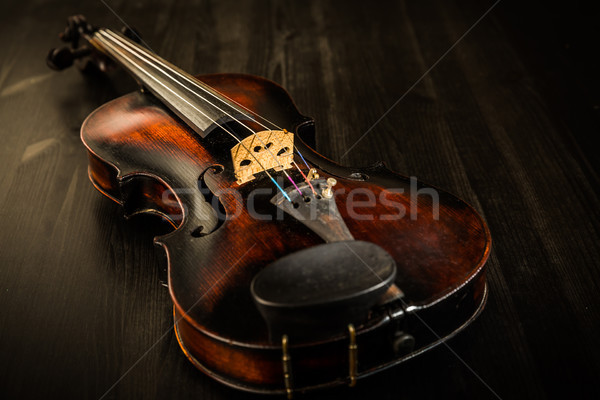 Old violin in vintage style on wood background Stock photo © brebca