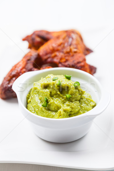 Grilled chicken wings with guacamole Stock photo © brebca