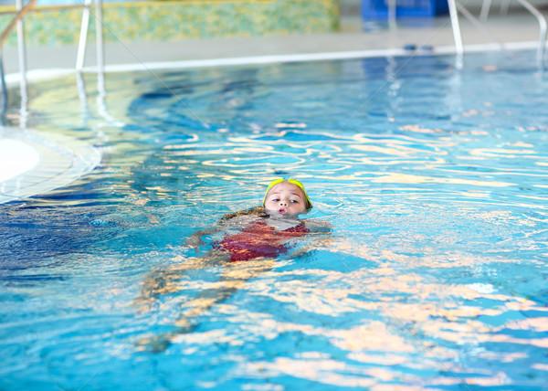 Child swimming backstroke  Stock photo © brebca