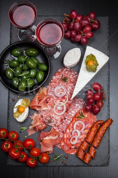 Antipasti aperitivos alimentos vino cena placa Foto stock © brebca