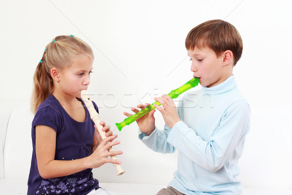 Kids playing flute Stock photo © brebca