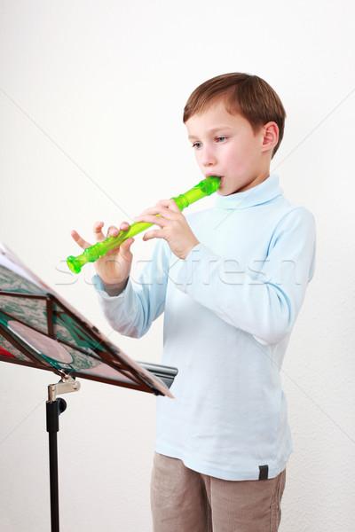 Little boy playing flute Stock photo © brebca