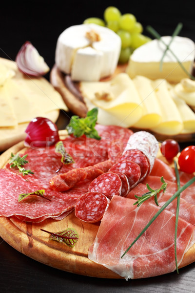 Salami and cheese platter with herbs Stock photo © brebca