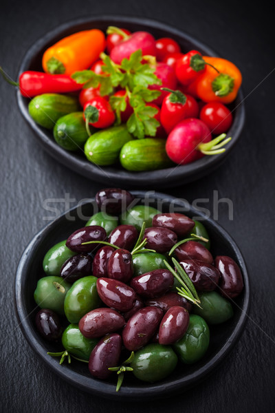 Mixed olives with raw snack vegetable Stock photo © brebca