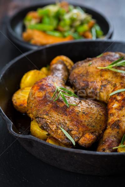 Baked chicken legs with potatos Stock photo © brebca
