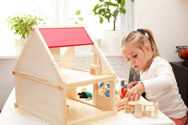 Playing with doll's house Stock photo © brebca