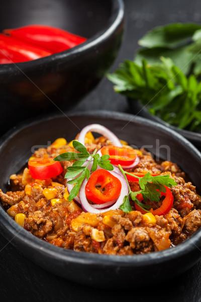 Geleneksel kırmızı biber pişmiş tava gıda plaka Stok fotoğraf © brebca