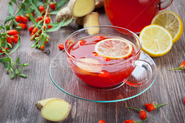 Tea with fresh goji berries and ginger Stock photo © brebca