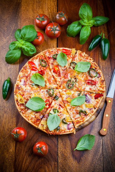 Hot chili pizza with jalapenos Stock photo © brebca