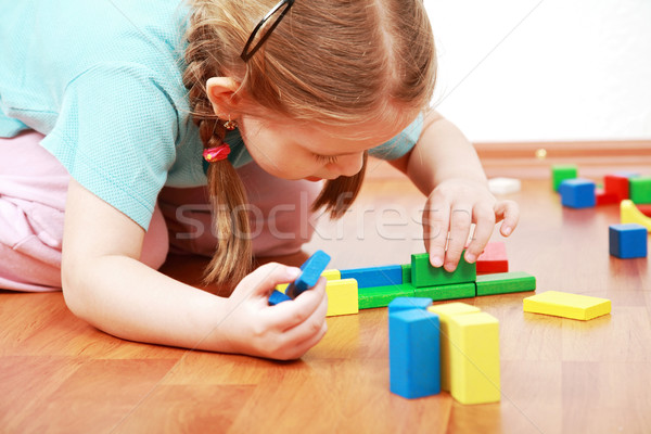 Adorable girl playing with blocks Stock photo © brebca