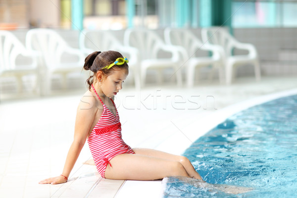 Child relaxing by swimming pool Stock photo © brebca