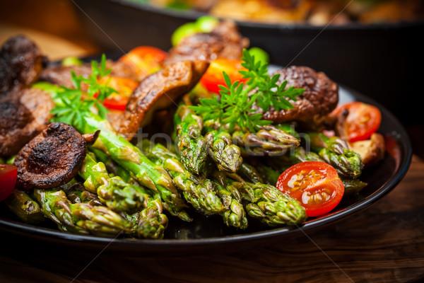 Green asparagus salad with roasted mushrooms Stock photo © brebca
