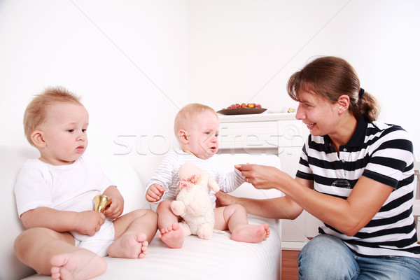 Mother with twins Stock photo © brebca