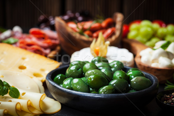 Antipasto with green olives Stock photo © brebca