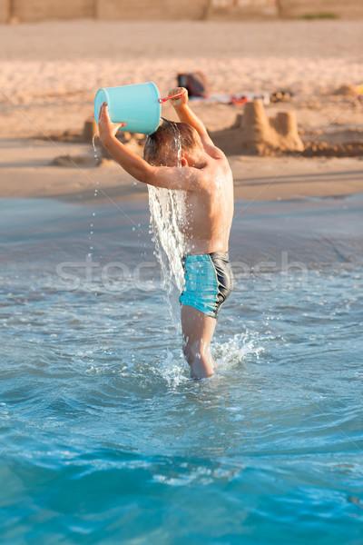 Hot summer - little boy splashing Stock photo © brebca