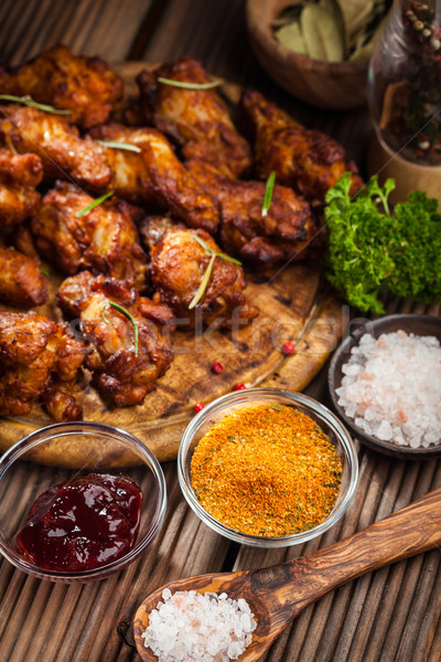BBQ chicken wings with spices and dip Stock photo © brebca