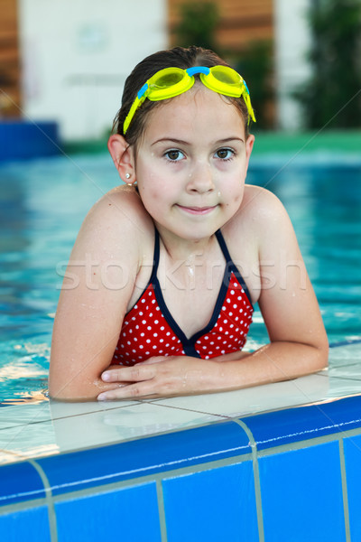 Schoolgirl with goggles in swimming pool Stock photo © brebca