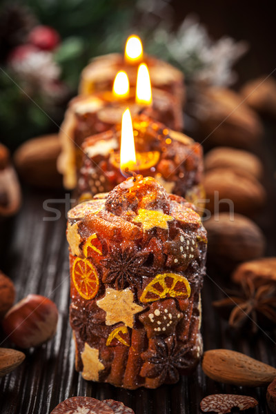 Rustic Christmas candles with spices and  nuts Stock photo © brebca