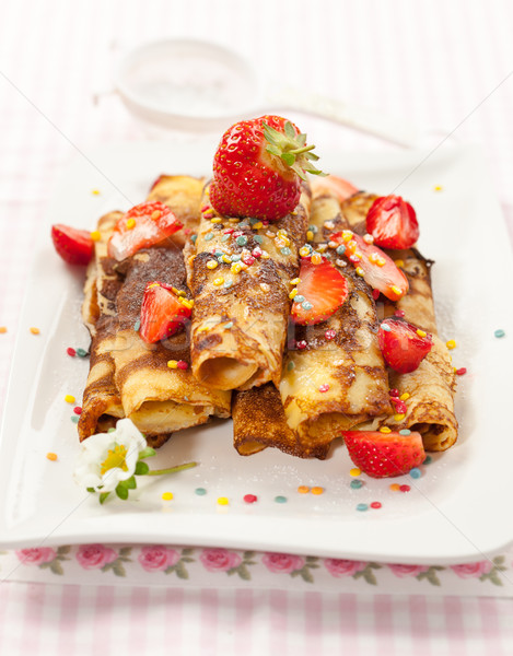 Rolled crepes with fresh strawberries Stock photo © brebca