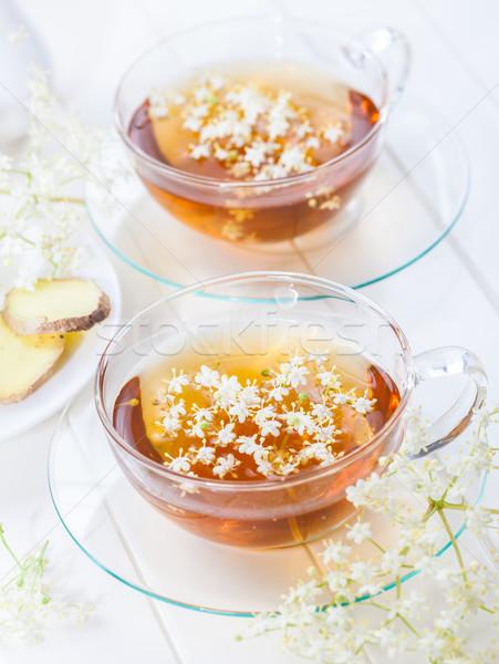 Cup of elder flower tea Stock photo © brebca