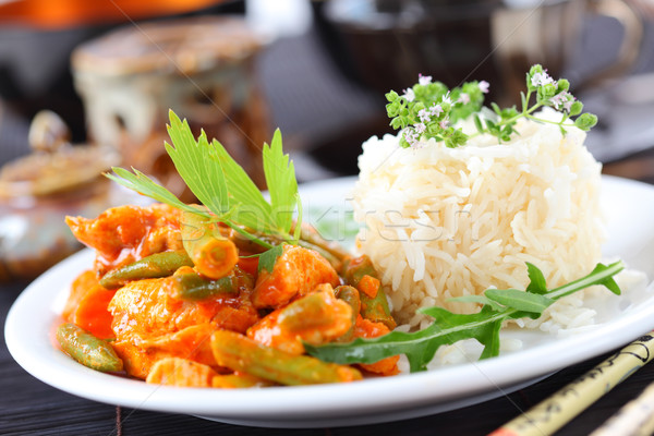 Red chicken curry stripes with rice Stock photo © brebca