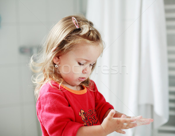 Small girl washing her hands Stock photo © brebca