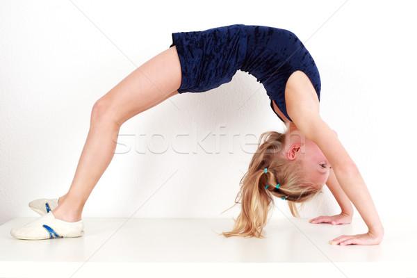 Girl child performing gymnastics Stock photo © brebca