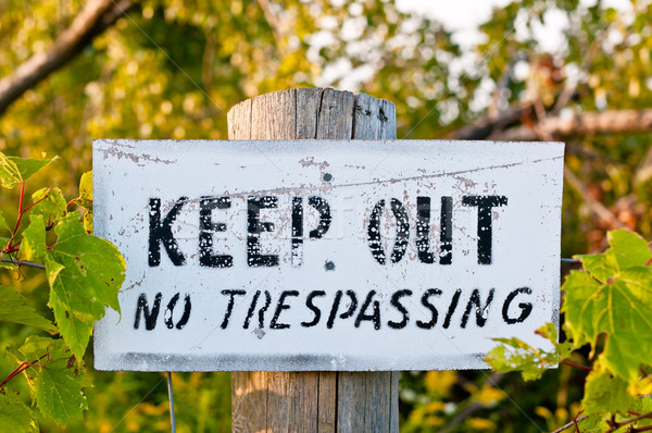 Weathered Keep Out Sign on a Wooden Post Stock photo © brianguest