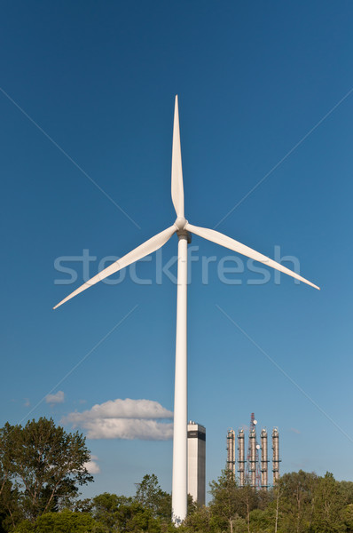 Large Wind Turbine with Trees and Blue Sky Stock photo © brianguest