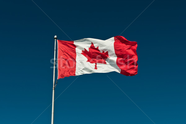 Big Canadian Flag against a Blue Sky Stock photo © brianguest