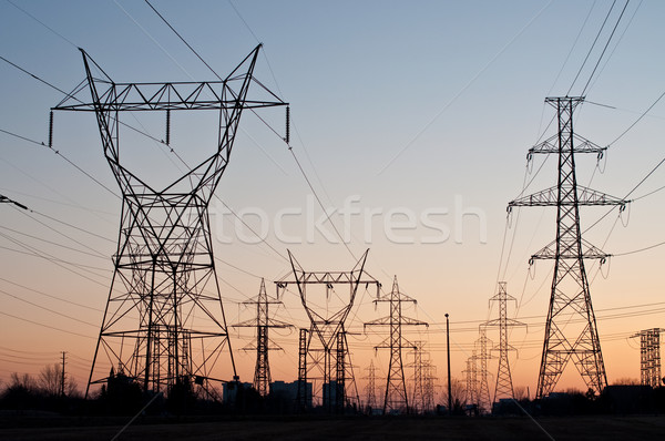 Electrical Transmission Towers (Electricity Pylons) at Sunset Stock photo © brianguest
