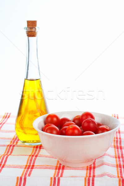 Stock photo: Olive oil bottle and red tomatos cherry