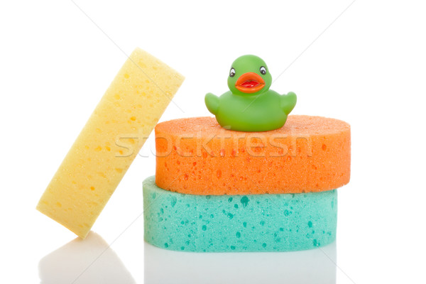 Three sponges and rubber duck Stock photo © broker