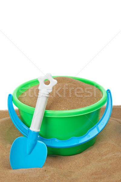 Praia brinquedos balde completo pá areia Foto stock © broker