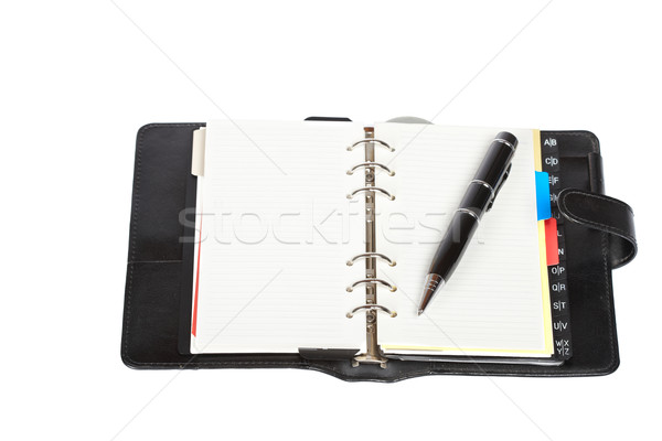 Opened agenda with pen Stock photo © broker