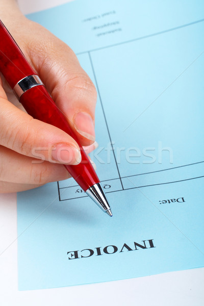 Writing blank invoice with pen Stock photo © broker