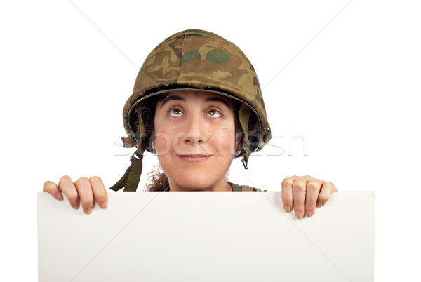 Curious soldier girl looking up Stock photo © broker