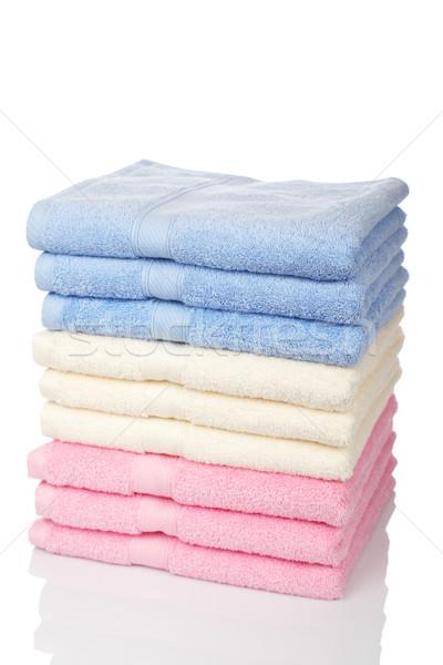 Tarka törölközők egymásra pakolva pihen fürdőszoba szín Stock fotó © broker