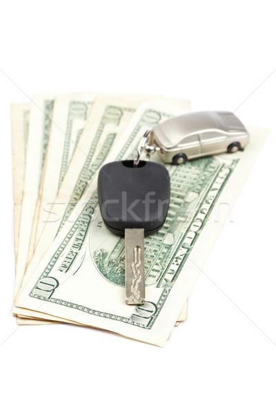 Slusszkulcs pénz dollár bankjegyek fehér sekély autó Stock fotó © broker