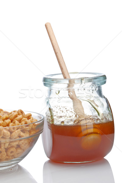 Honey and cereals Stock photo © broker