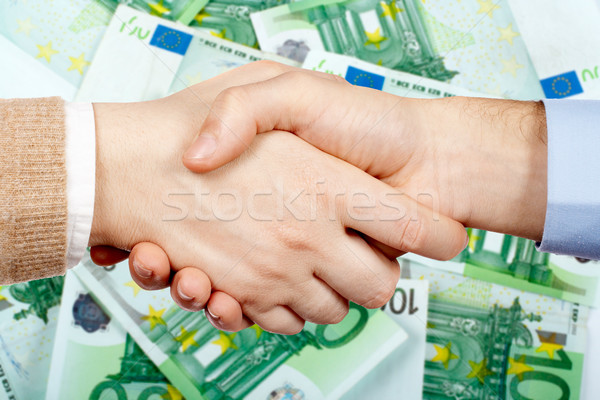 Handshake argent affaires euros bureau main Photo stock © broker