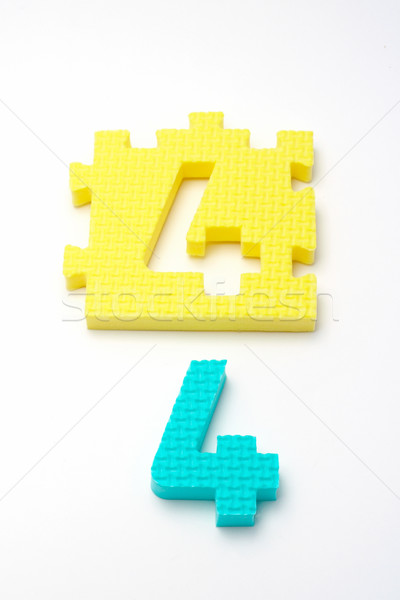 Number four puzzle mats. Focus on the front (small DOF) Stock photo © broker