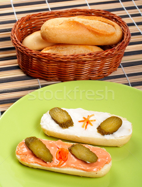 Two canapes on a porcelain plate, and bread on a basket Stock photo © broker