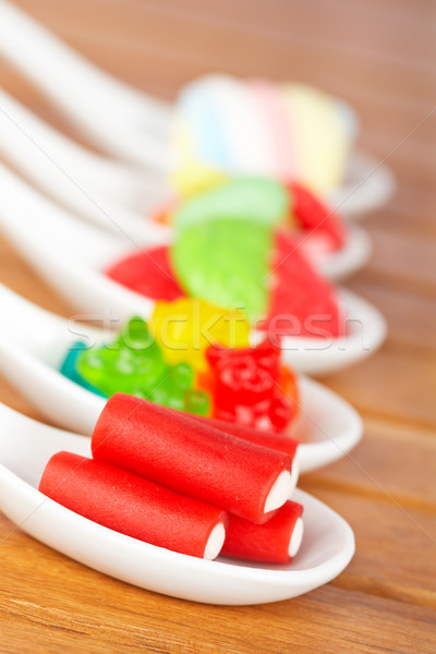 Candies in the spoons Stock photo © broker