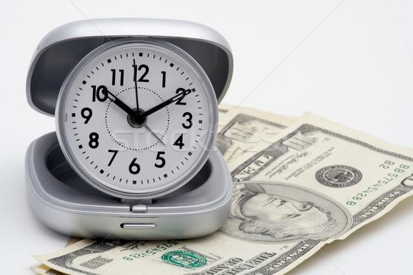 Relógio dinheiro dólares isolado branco trabalhar Foto stock © broker