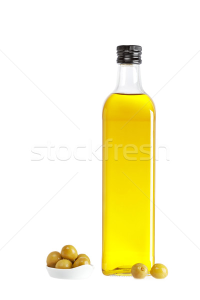 Olive oil bottle and some olives Stock photo © broker