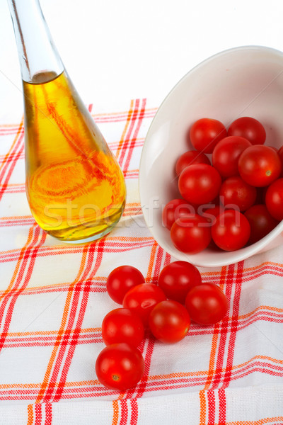 Stock photo: Oil bottle and tomatos cherry