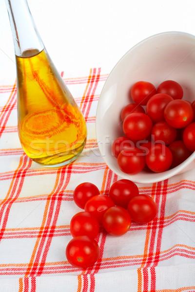 Oil bottle and tomatos cherry Stock photo © broker