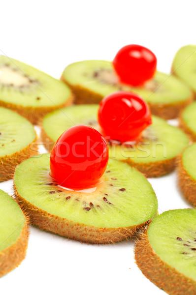 Kiwis slices with cherries Stock photo © broker